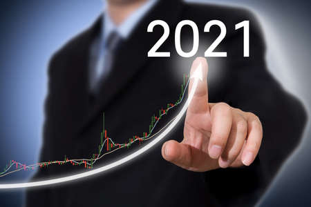 Development and growth 2021 with businessman pointing finger