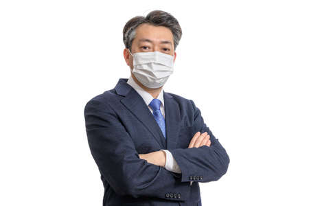 Portrait of a middle-aged Asian businessman wearing a white face mask. White Background.