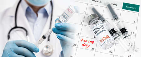 A calendar with the date of the vaccination with the doctor holding the vaccination shot.