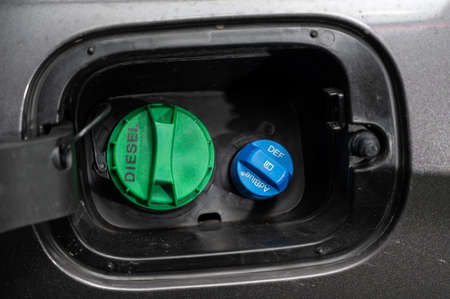 Seoul, South Korea - Jan 2021 : Adblue diesel exhaust fluid DEF and diesel fuel tank cap.