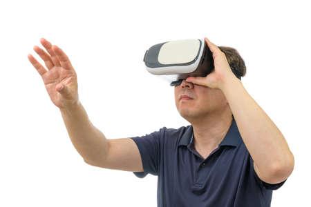 Man wearing virtual reality goggles. Studio shot, white background.