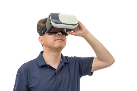Man wearing virtual reality goggles. Studio shot, white background. Stock fotó - 167444236