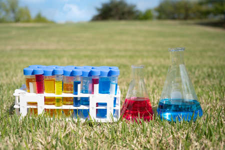 Scientific experiment tools on the lawn. Education concept.