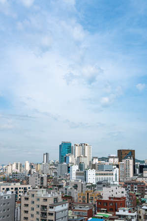 Cityscape of Seoul, South Korea with houses and buildings. Copy space in the sky.