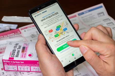 Seoul, South Korea - June 2021: Using Naver's real-time COVID-19 'Residual Vaccine' reservation mobile app. Sajtókép