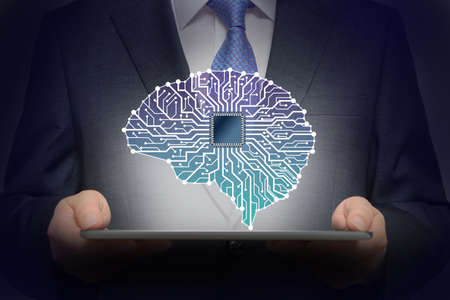 Businessman with Artificial Intelligence brain connects to technology network concept. Stock fotó