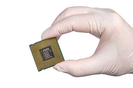 holding CPU wearing white gloves on white background.
