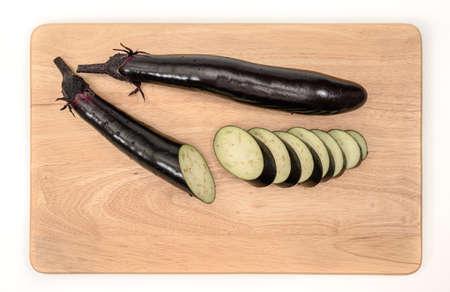 eggplant or aubergine vegetable on cutting board