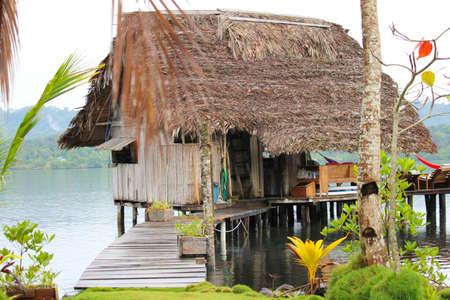 bocas del toro: A rustic beach cabin on stilts over water on the beach in Bocas del Toro, Panama