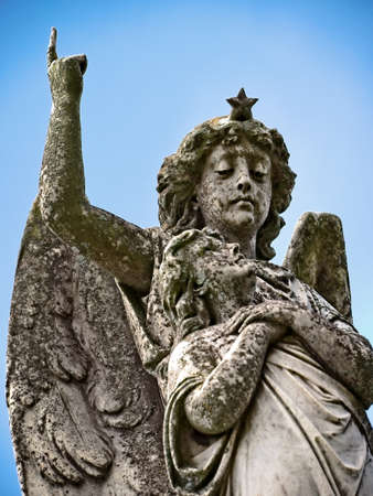 New Orleans, LA USA - Jun 2, 2017  -  Angel and Women on top of Tomb