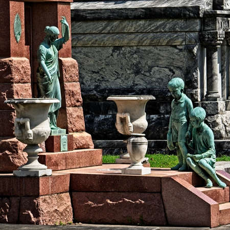 New Orleans, LA USA - Jun 2, 2017  -  Boy Girl and Women Statue on Tomb