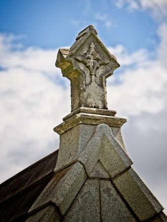 New Orleans, LA USA - Jun 2, 2017  -  Cross on top of a Tomb 3