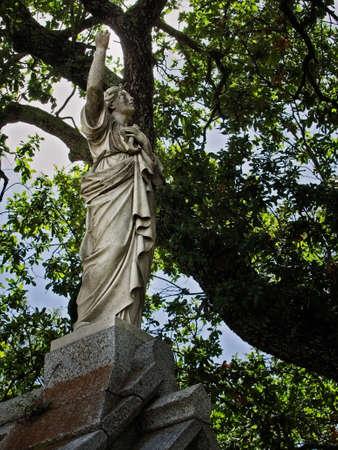 New Orleans, LA USA - Jun 2, 2017  -  Statue of a Person on a Tomb
