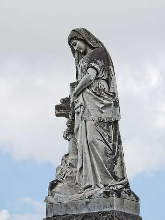 New Orleans, LA USA - Jun 2, 2017  -  Statue of Woman on of a Tomb