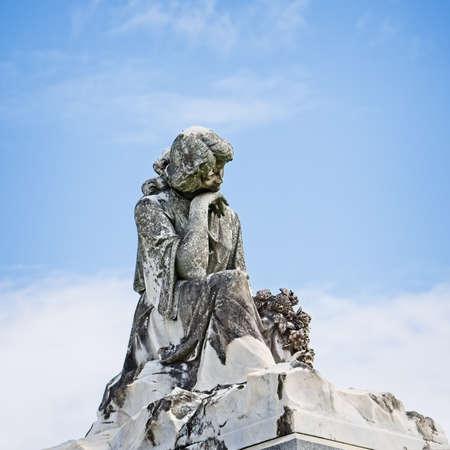 New Orleans, LA USA - Jun 2, 2017  -  Statue of Women on Tomb