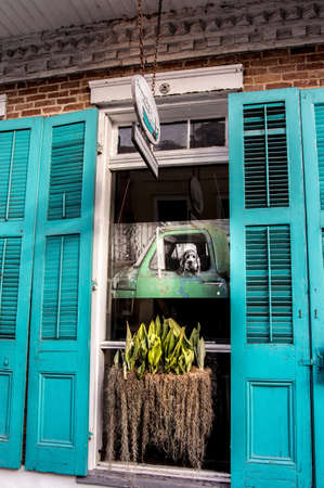 New Orleans, LA USA 63015:  This is a photography of a dog looking out of a truck window setup in a display window.  Makes for a interesting photo of a photo. Editorial