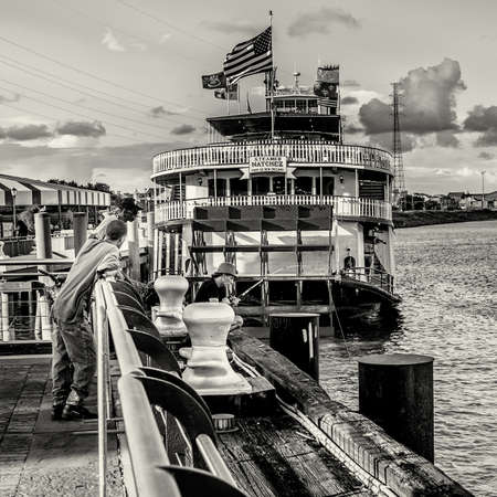 New Orleans LA USA -  Sep. 13, 2016  - This guy was fishing in the Mississippi River behind the Steamer Natchez and caught a Sting Ray.  The other two guys went nuts when he pulled it in thinking the fishermen was going to be stung and die!  Wish I would  Editorial