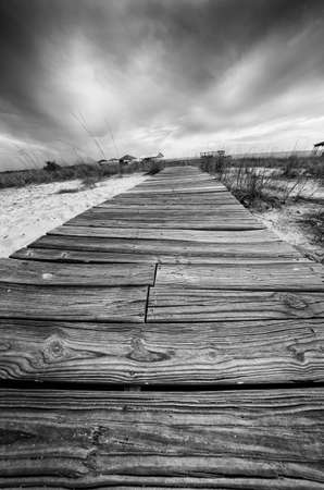 Point Clear AL USA - May 2, 2014  -  Wooden walkway across the sand in Black and White Редакционное
