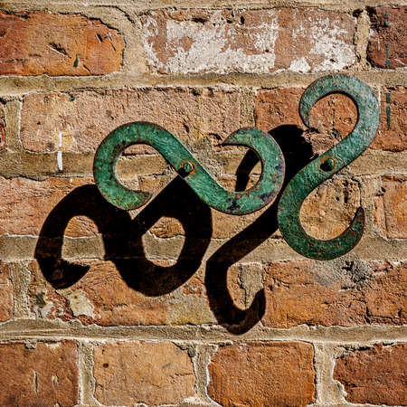 New Orleans, LA, USA -  Sep. 12, 2016  -  Z or backwards S patterned on a brick wall with shadows found in the French Quarter in New Orleans USA