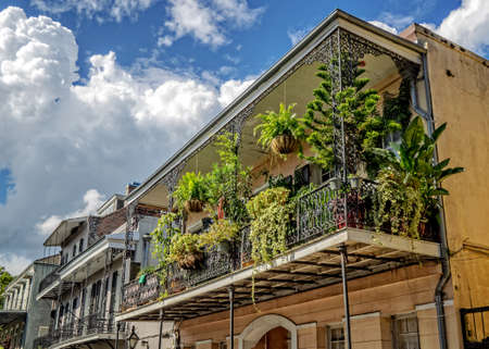 New Orleans, LA, USA -  Sep. 12, 2016  -  Balconies with Plants and Flages in the French Quarter of New Orleans