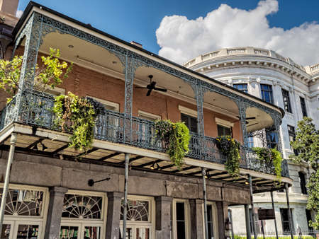 New Orleans, LA, USA -  Sep. 12, 2016  -  Balconies with Plants and the Louisiana Supreme Court in the background in the French Quarter of New Orleans