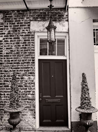 New Orleans, LA USA - May 9, 2018  -  Light Fixture and Door in the French Quarter