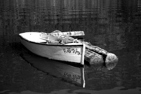 A row boat on calm water. photo