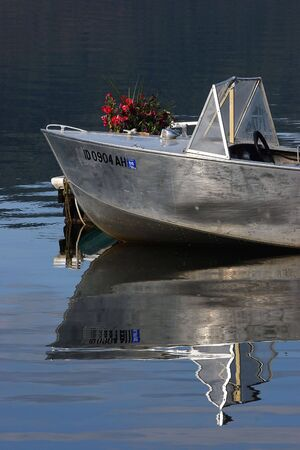 aluminum: Aluminum boats reflection.