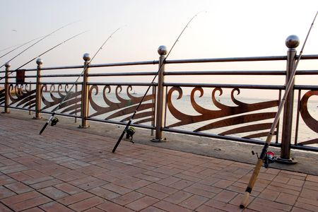 lined up: Fishing poles lined up along the coast of Inchon, Korea.