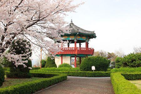 A brick path leads to a Korean pavilion.