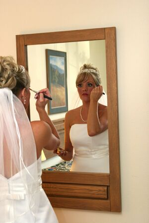 The bride applies make up before the wedding. Stock Photo - 3588559