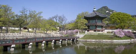 A wooden footbridge leads to an old pavilion at Kyoungbok Palace in Seoul, Korea. Stock Photo