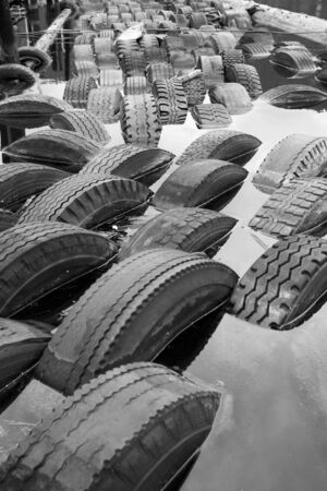bounded: Old tires bounded together to act as a barrier.