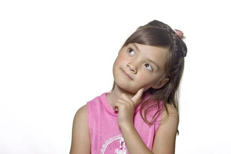 A young girl strikes a thoughtful pose. photo