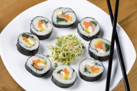 chinese spinach: A plate of healthy Korean sushi called kimbap.