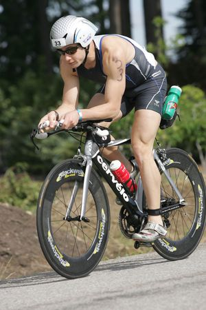 Pro triathlete David Kahn of Port Jefferson, NY on the bike portion of the Ironman Triathlon in Coeur dAlene, Idaho. 06212009