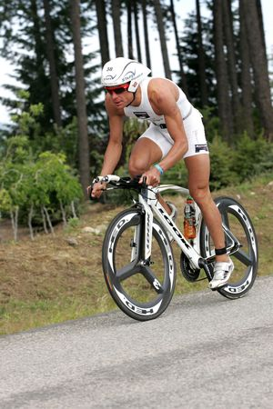 Pro triathlete Maximillian Longree of San Francisco, CA on the bike portion of the Ironman Triathlon in Coeur dAlene, Idaho. 06212009