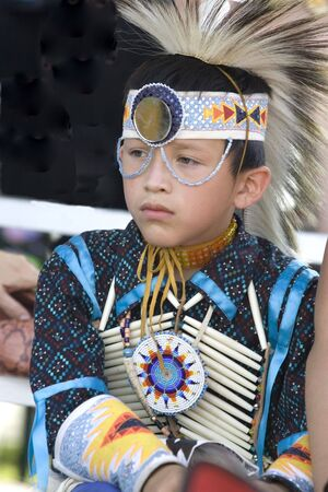 A young native American in full dress at the Julyamsh Powwow in Post Falls, Idaho. 07252009