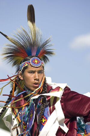 A young native American teen in full dress participates in the dance at the Julyamsh Powwow in Post Falls, Idaho. 07/25/2009 Editöryel