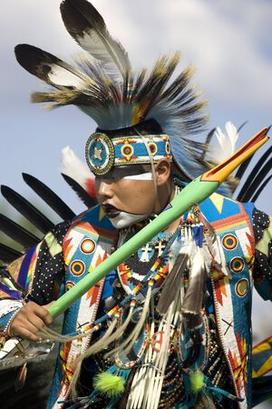 A native American teen in full dress dances at the Julyamsh Powwow in Post Falls, Idaho. 07/25/2009