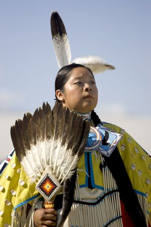 A native American teen in full dress participates in ceremony at the Julyamsh Powwow in Post Falls, Idaho. 07252009