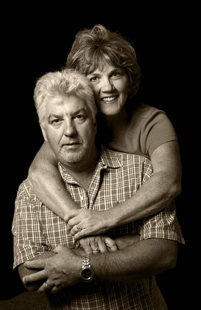 A low key portrait of a middle aged husband and wife. Stock Photo - 6412978
