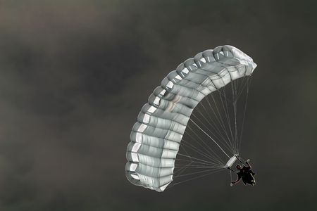 solarize: A solarized image of a skydiver gliding through the air with his parachute. Stock Photo