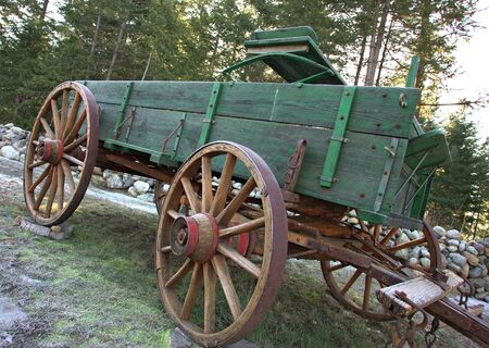 The metal lined wooden wheel of this vintage wagon. photo