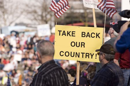 april 15: Take back our country sign at the Spokane, Washington tea party rally on April 15, 2010.