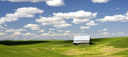 A barn in a large field in the Palouse region of Washington. photo
