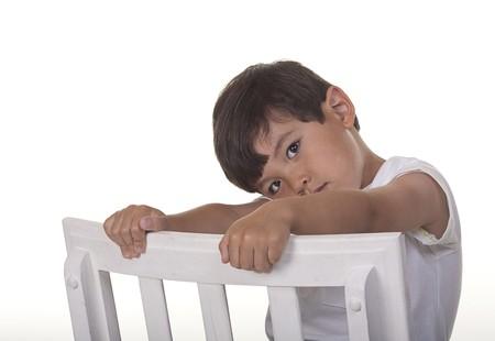 bashful: A studio image of a bashful young boy.