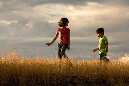 A brother and sister in their own little adventure walk. Stok Fotoğraf