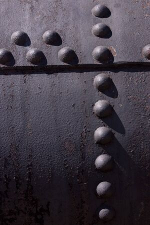 rivets: A textured picture of rivets in old iron.