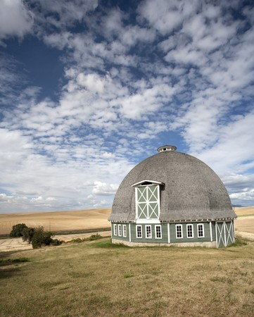 A scenic view of a round barn with a blue sky in the background. Stock Photo - 7847234